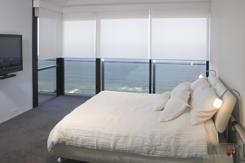 Lovley light filtering rollet blinds in a bedroom