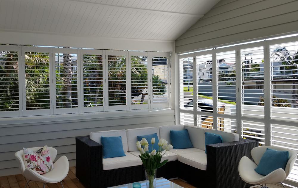 White Santa Fe shutters on porch