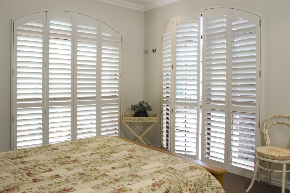 White Santa Fe shaped shutter in bedroom