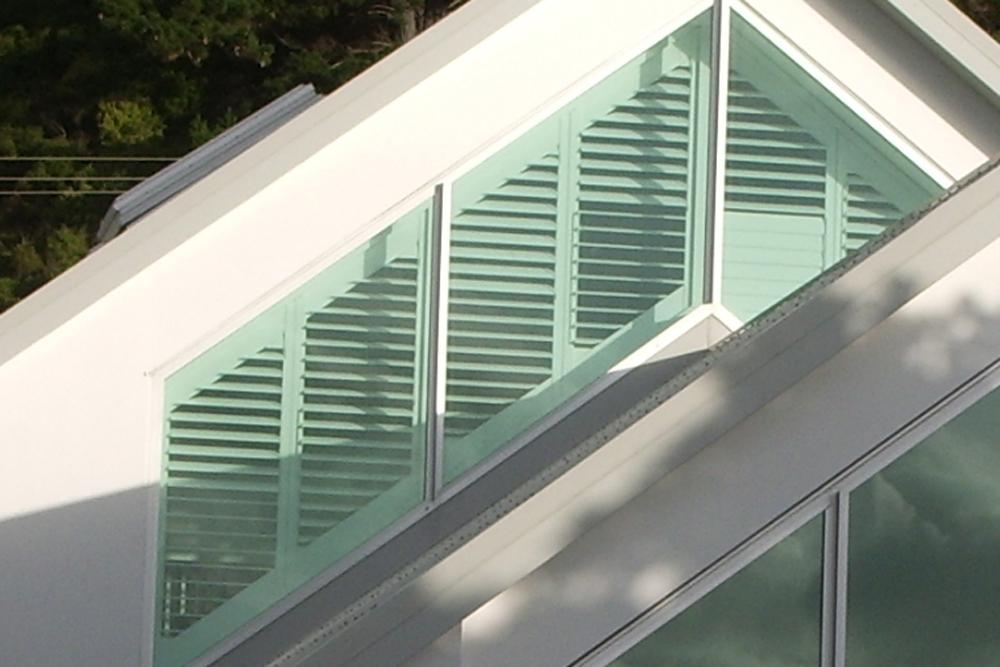 White shutters in a shaped window