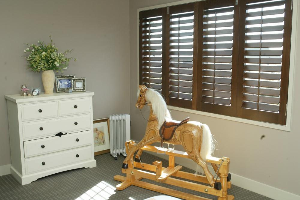 Brown Santa Fe shutters in child's room