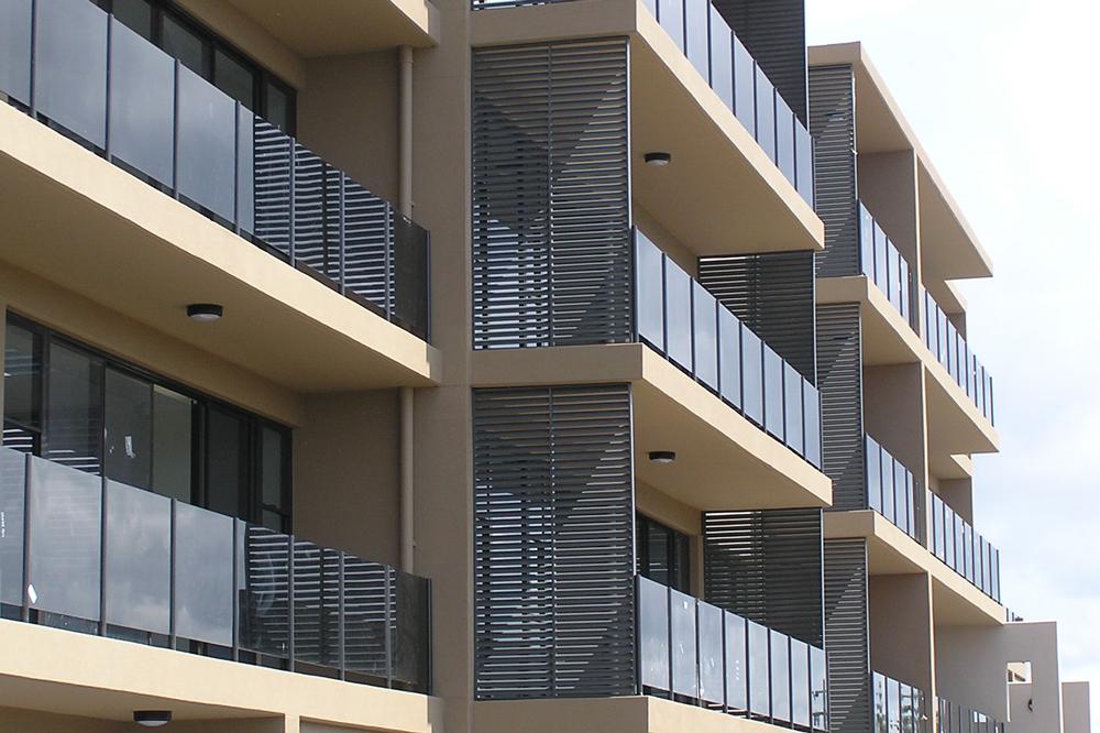 Grey Santa Fe aluminum screens on building