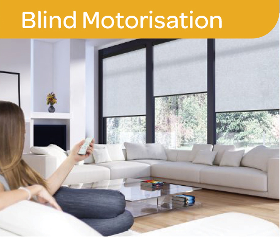 Woman on a couch using device to put down blinds