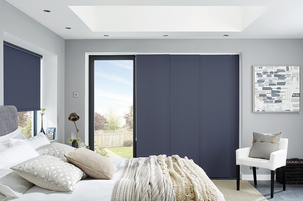 Blue Panel Curtain and roller blind in a bedroom