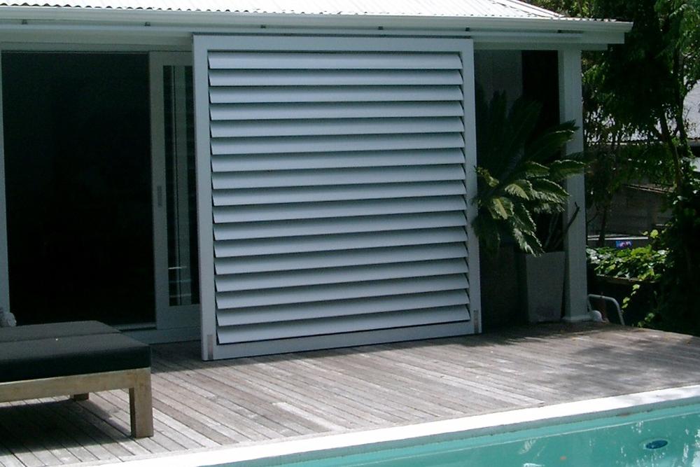 Grey aluminum sliding shutter by pool