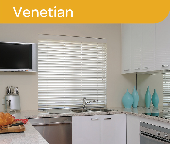 White venetian blinds pulled down in a white kitchen