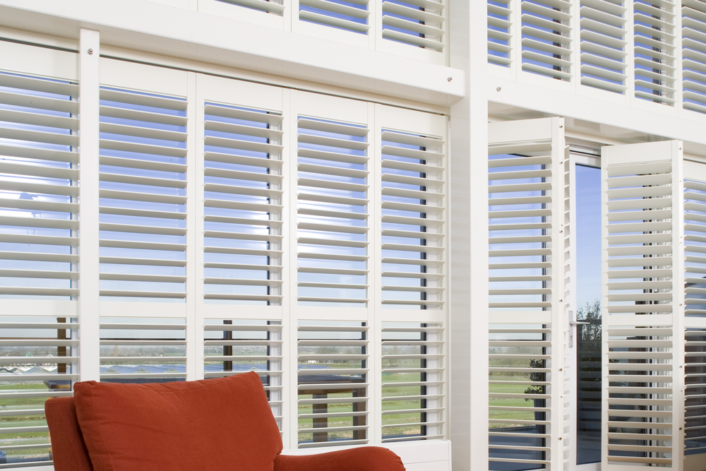 White Santa Fe shutters used as window and door covering