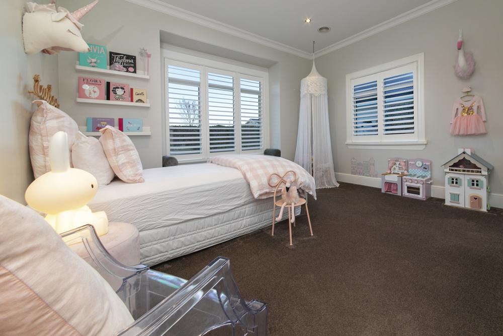 Modern Santa Fe shutters in girl's bedroom