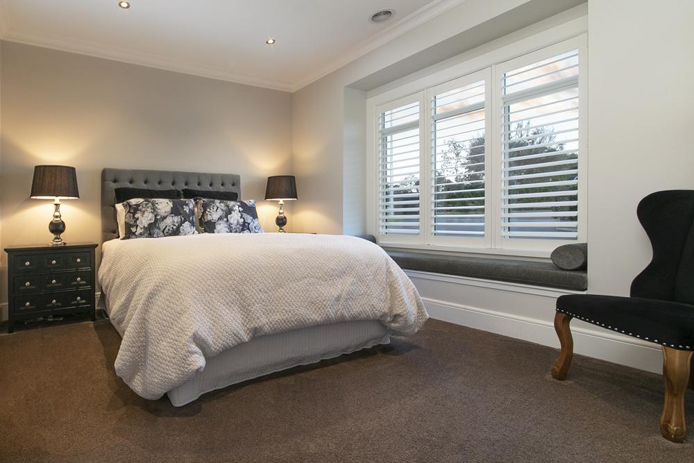 Modern Santa Fe shutters in bedroom