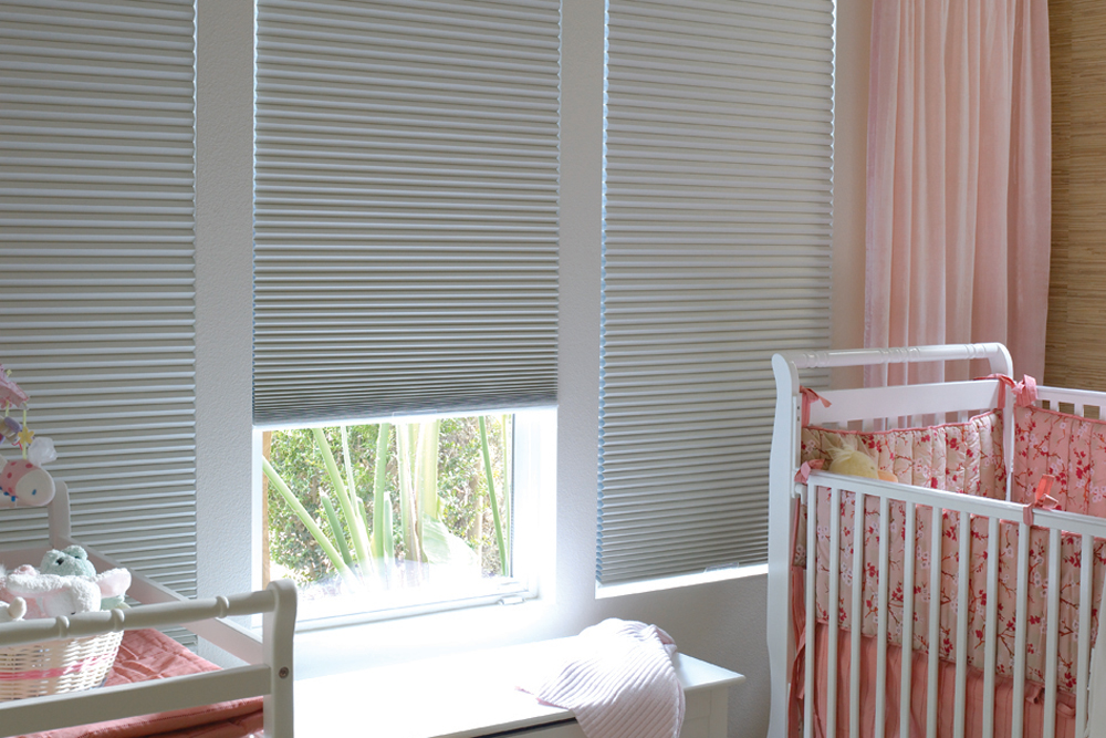 White Thermacell honeycomb blinds in baby's room