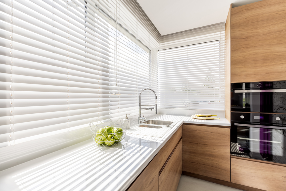 White venetians blinds in a kitchen